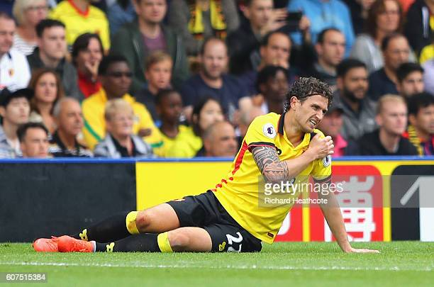 Daryl Janmaat of Watford holds his shoulder after a challenge during the Premier League match between Watford and Manchester United at Vicarage Road...