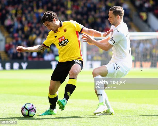Daryl Janmaat of Watford is put under pressure from Gylfi Sigurdsson of Swansea City during the Premier League match between Watford and Swansea City...