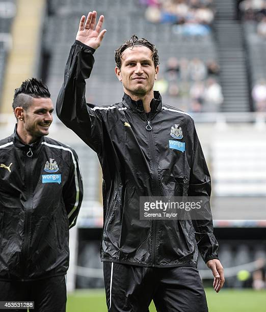Daryl Janmaat waves to the fans prior to a Newcastle United Training Session at StJames' Park on August 12 in Newcastle upon Tyne England