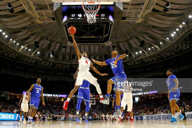 Daryl Macon of the Arkansas Razorbacks goes up for a shot against Rashed Anthony of the Seton Hall Pirates in the first half in the first round of...