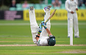 Daryl Mitchell of Worcestershire rolls on the ground after ducking under a delivery from Boyd Rankin of Warwickshire during the LV County...