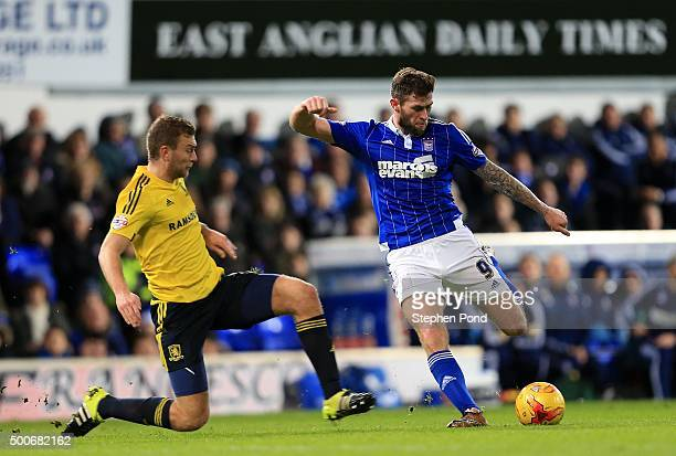 Daryl Murphy of Ipswich Town and Ben Gibson of Middlesbrough compete for the ball during the Sky Bet Championship match between Ipswich Town and...