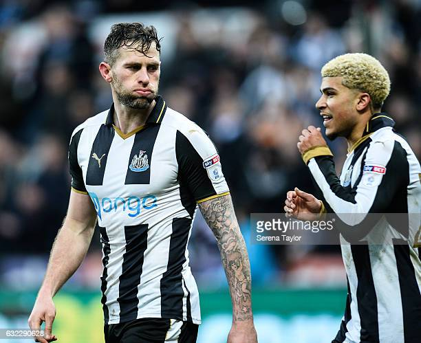 Daryl Murphy of Newcastle United celebrates with teammate DeAndre Yedlin after scoring the opening goal during the Sky Bet Championship match between...