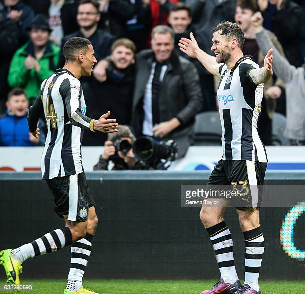 Daryl Murphy of Newcastle United celebrates with teammate Isaac Hayden after scoring the opening goal during the Sky Bet Championship match between...