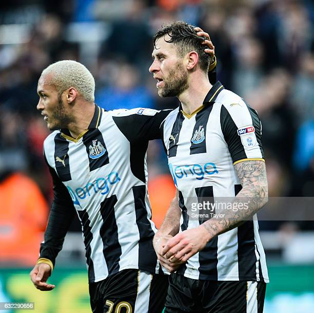 Daryl Murphy of Newcastle United celebrates with teammate Yoan Gouffran after scoring the opening goal during the Sky Bet Championship match between...