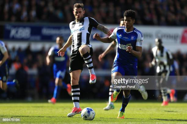 Daryl Murphy of Newcastle United controls the ball ahead of Jordan Spence of Ipswich Town during the Sky Bet Championship match between Ipswich Town...