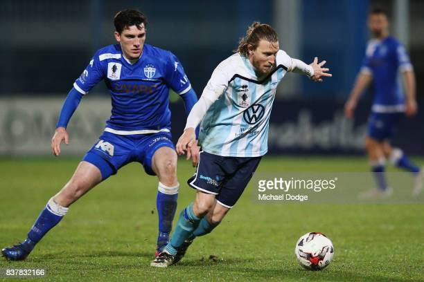 Daryl Platten of Sorrento controls the ball from Matthew Millar of South Melbourne during the FFA Cup round of 16 match between between South...