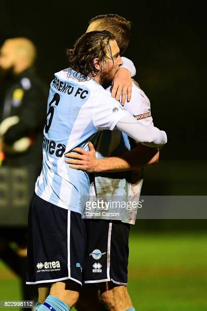 Daryl Platten of Sorrento FC embraces a team mate on the final whistle during the FFA Cup round of 32 match between Sorrento FC and Canberra Olympic...
