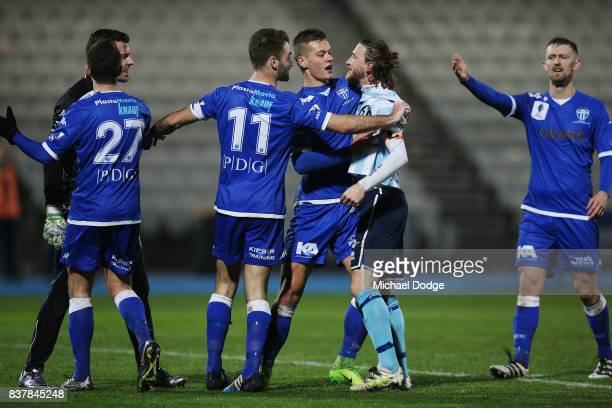 Daryl Platten of Sorrento tries to confront Goalkeeper Nikola Roganovic of South Melbourne during the FFA Cup round of 16 match between between South...