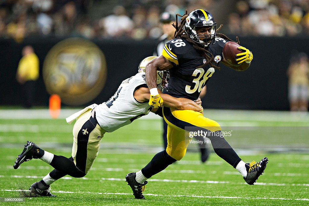 Daryl Richardson #38 of the Pittsburgh Steelers runs the ball and is tackled by Roman Harper #41 of the New Orleans Saints at Mercedes-Benz Superdome on August 26, 2016 in New Orleans, Louisiana. The Steelers defeated the Saints 27-14.