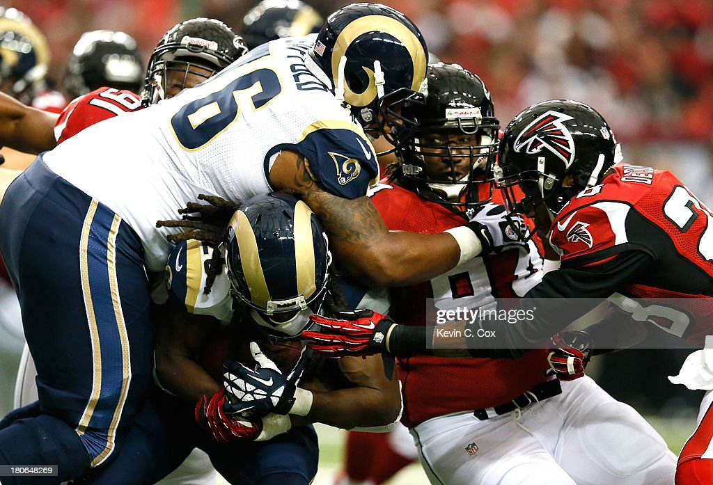 <a gi-track='captionPersonalityLinkClicked' href=/galleries/search?phrase=Daryl+Richardson&family=editorial&specificpeople=9206924 ng-click='$event.stopPropagation()'>Daryl Richardson</a> #26 of the St. Louis Rams is tackled by Peria Jerry #94 and <a gi-track='captionPersonalityLinkClicked' href=/galleries/search?phrase=Thomas+DeCoud&family=editorial&specificpeople=4037323 ng-click='$event.stopPropagation()'>Thomas DeCoud</a> #28 of the Atlanta Falcons at Georgia Dome on September 15, 2013 in Atlanta, Georgia.