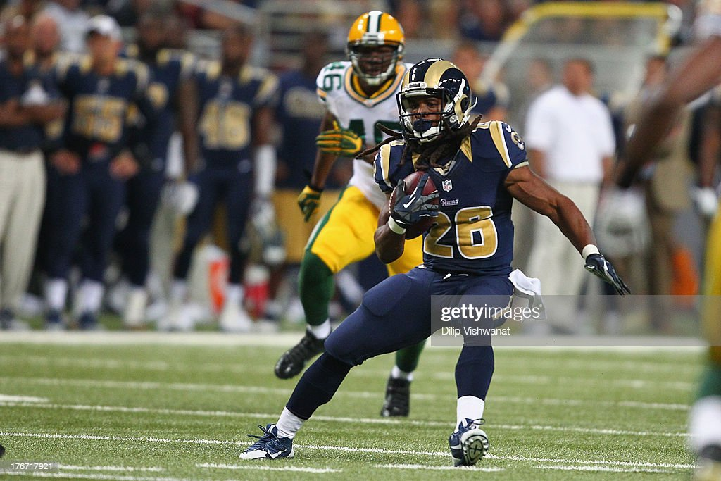 Daryl Richardson #26 of the St. Louis Rams rushes against the Green Bay Packers after catching a pass during a preseason game at the Edward Jones Dome on August 17, 2013 in St. Louis, Missouri.