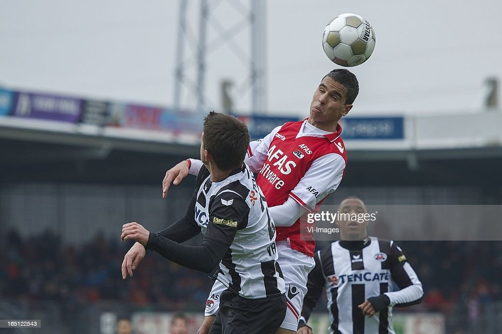 Daryl van Mieghem of Heracles Almelo, Adam Maher of AZ during the Dutch Eredivisie match between Heracles Almelo and AZ Alkmaar at the Polman Stadium on march 31, 2013 in Almelo, The Netherlands