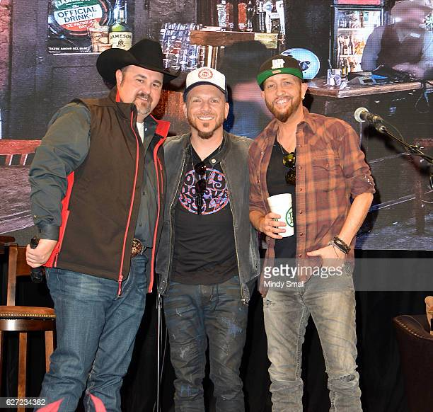 Daryle Singletary poses with Chris Lucas and Preston Brust of country music duo LoCash during the 'Keepin' it Country with Daryle Singletary' show...