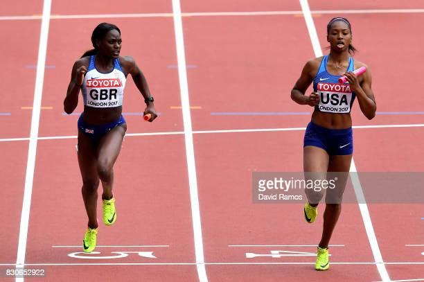 Daryll Neita of Great Britain and Ariana Washington of the United States compete during the 4 X 100 Metres Relay heats during day nine of the 16th...