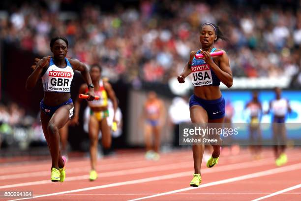 Daryll Neita of Great Britain and Ariana Washington of the United States compete in the Women's 4x100 metres relay heats during day nine of the 16th...