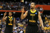 Da'Sean Butler and Devin Ebanks of the West Virginia Mountaineers react in the second half against the Kentucky Wildcats during the east regional...