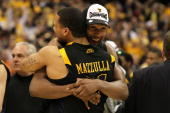Da'Sean Butler and Joe Mazzulla of the West Virginia Mountaineers celebrate after they won 7366 against the Kentucky Wildcats during the east...