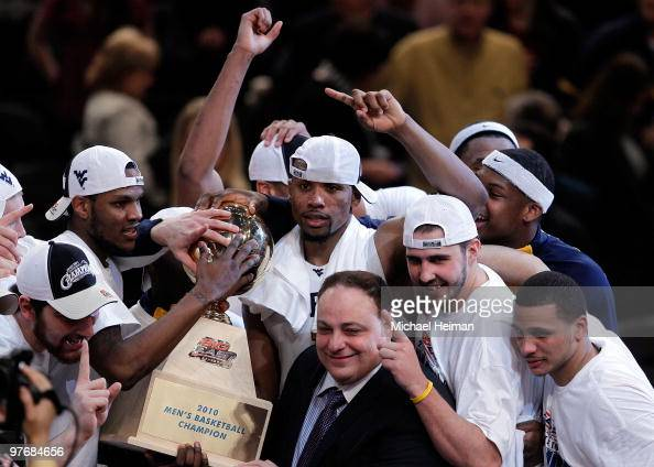 Da'Sean Butler and the West Virginia Mountaineers celebrate with the trophy after defeating the Georgetown Hoyas during the championship of the 2010...
