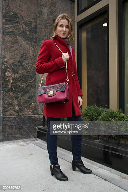 Dasha Chmykhova is seen on Michigan Avenue wearing a pink and purple leather Vif bag and wool red Calvin Klein coat on December 10 2015 in Chicago...