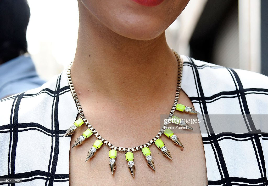 Dasha Gold(accessories detail) outside the DKNY show wearing an Australian designers outfit on September 8, 2013 in New York City.