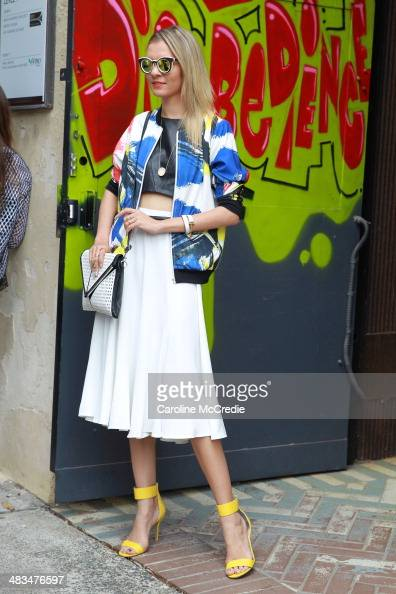 Dasha Gold wearing Black by Deng Bomber skirt by Lauren Dameilian top by Blessed Are The Meek Nicki From Peep Toe Shoes necklace by House of Harlow...
