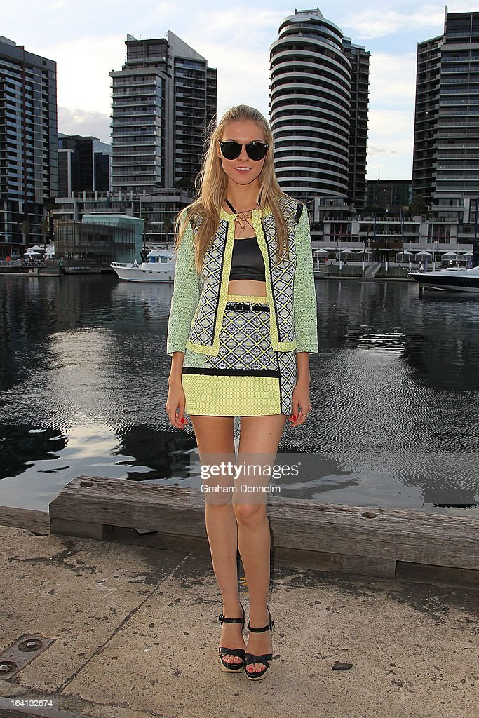 Dasha Gold wears a jacket and skirt by MSGM, sunglasses by Karen Walker and shoes by RMK on day three at L'Oreal Melbourne Fashion Festival on March 20, 2013 in Melbourne, Australia.