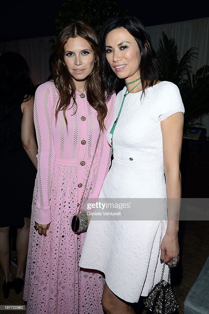 Dasha Zhukova and Wendi Murdoch attend Chanel beachside BBQ celebrating Art.sy at Soho Beach House on December 5, 2012 in Miami Beach, Florida.