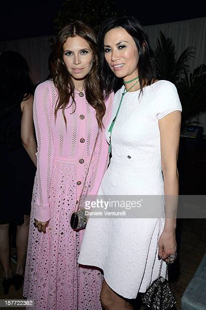 Dasha Zhukova and Wendi Murdoch attend Chanel beachside BBQ celebrating Artsy at Soho Beach House on December 5 2012 in Miami Beach Florida