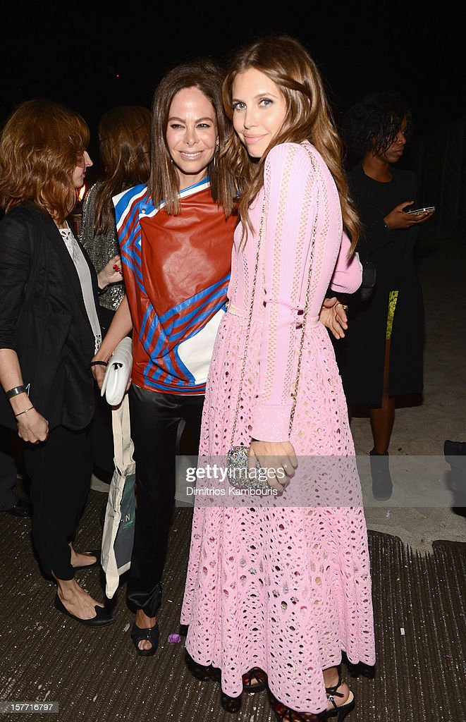 Dasha Zhukova (R) attends a Beachside Barbecue presented by CHANEL hosted by Art.sy Founder Carter Cleveland, Larry Gagosian, Wendi Murdoch, Peter Thiel and Dasha Zhukova at Soho Beach House on December 5, 2012 in Miami Beach, Florida.