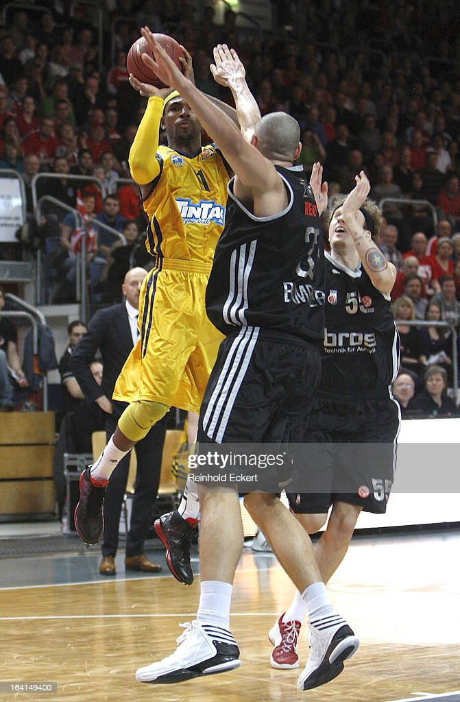 Dashaun Wood, #23 of Alba Berlin competes with Maik Zirbes, #33 of Brose Baskets Bamberg during the 2012-2013 Turkish Airlines Euroleague Top 16 Date 12 between Brose Baskets Bamberg v Alba Berlin at Stechert Arena on March 20, 2013 in Bamberg, Germany.