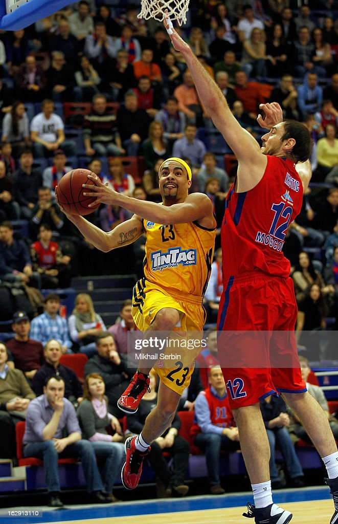Dashaun Wood #23 of Alba Berlin competes with Nenad Krstic #12 of CSKA Moscow in action during the 20122013 Turkish Airlines Euroleague Top 16 Date 9...
