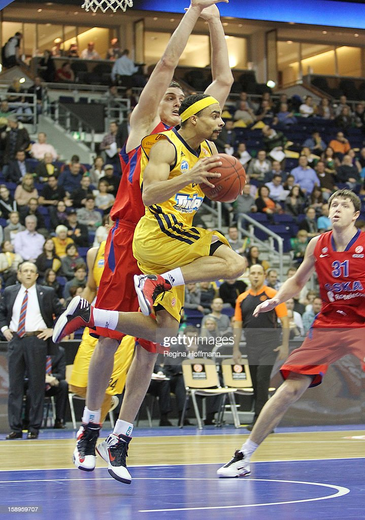 Dashaun Wood #23 of Alba Berlin competes with Sasha Kaun #24 of CSKA Moscow during the 20122013 Turkish Airlines Euroleague Top 16 Date 2 between...