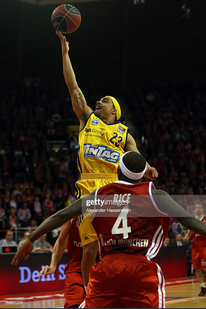 DaShaun Wood of Berlin shoots against Tyrese Rice of Muenchen during Game 3 of the quarterfinals of the Beko Basketball Playoffs between FC Bayern Muenchen and ALBA Berlin at Audi-Dome on May 12, 2013 in Munich, Germany.