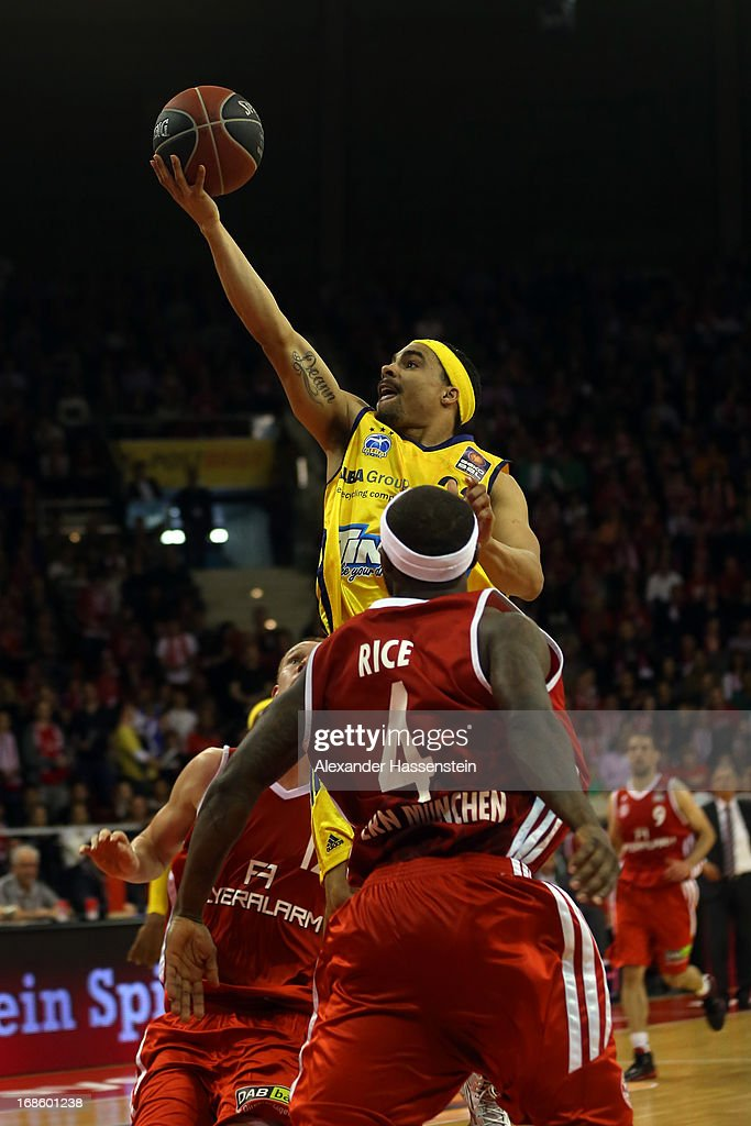 DaShaun Wood of Berlin shoots against Tyrese Rice of Muenchen during Game 3 of the quarterfinals of the Beko Basketball Playoffs between FC Bayern...