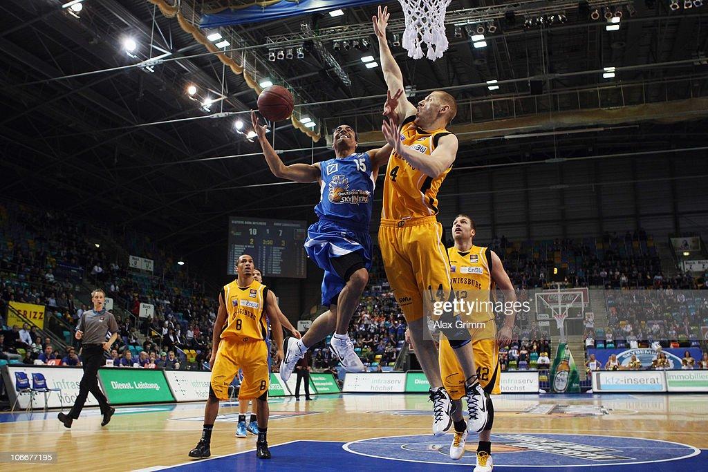 DaShaun Wood of Frankfurt is challenged by Donatas Zavackas of Ludwigsburg during the Beko Basketball Bundesliga match between Deutsche Bank...