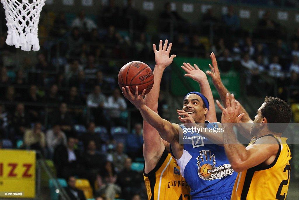 DaShaun Wood of Frankfurt tries to score against Toby Bailey and John Bowler of Ludwigsburg during the Beko Basketball Bundesliga match between...