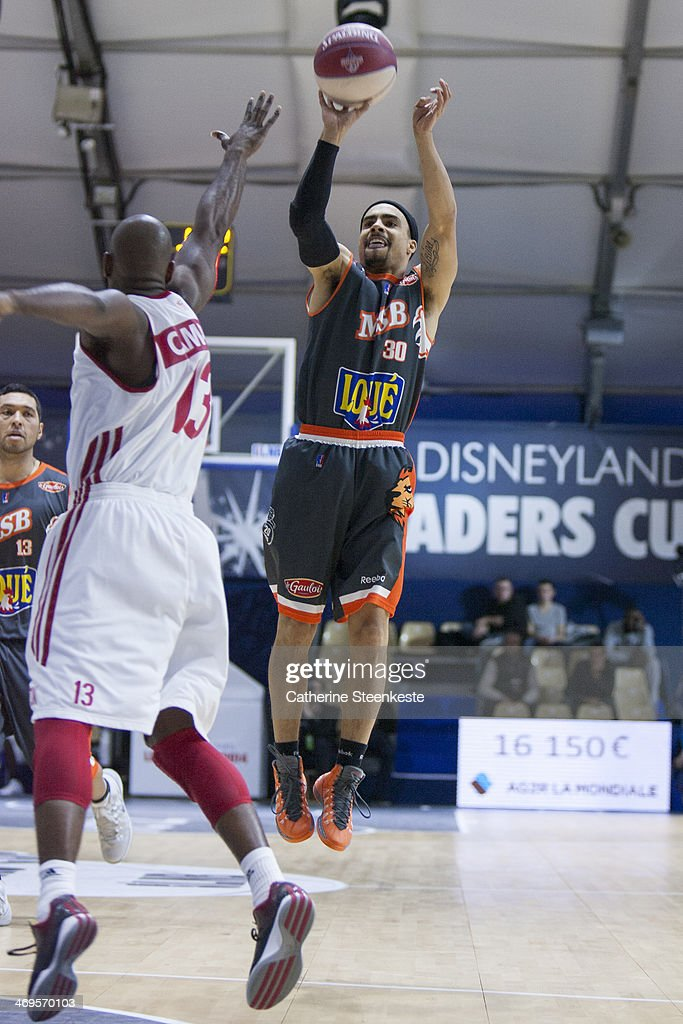 DaShaun Wood of Le Mans is shooting the ball against Louis Campbell of Strasbourg during the game between Strasbourg and Le Mans at Disney Events...