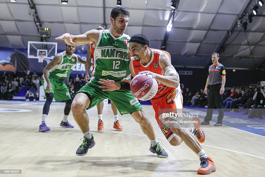 DaShaun Wood of Le Mans is trying to go to the basket against Kevin Lisch of Nanterre during the game between Le Mans and Nanterre at Disney Events...