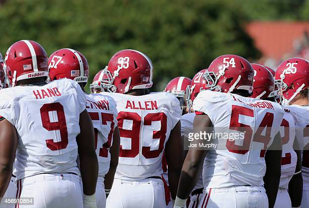 Da'Shawn Hand Xzavier Dickson Jonathan Allen and Dalvin Tomlinson of the Alabama Crimson Tide huddle with the defense against the Ole Miss Rebels on...