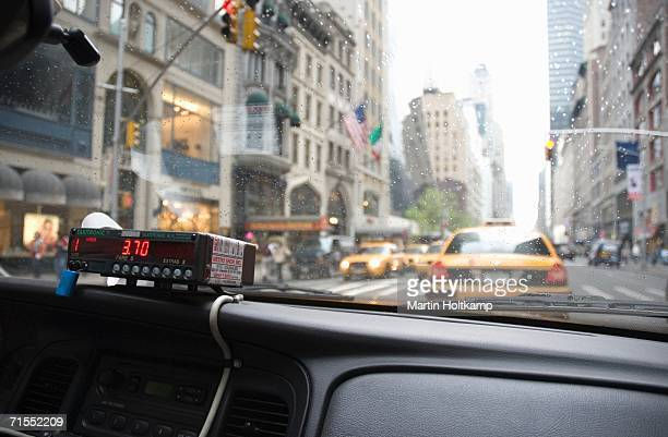 Dashboard and meter inside taxi, New York City