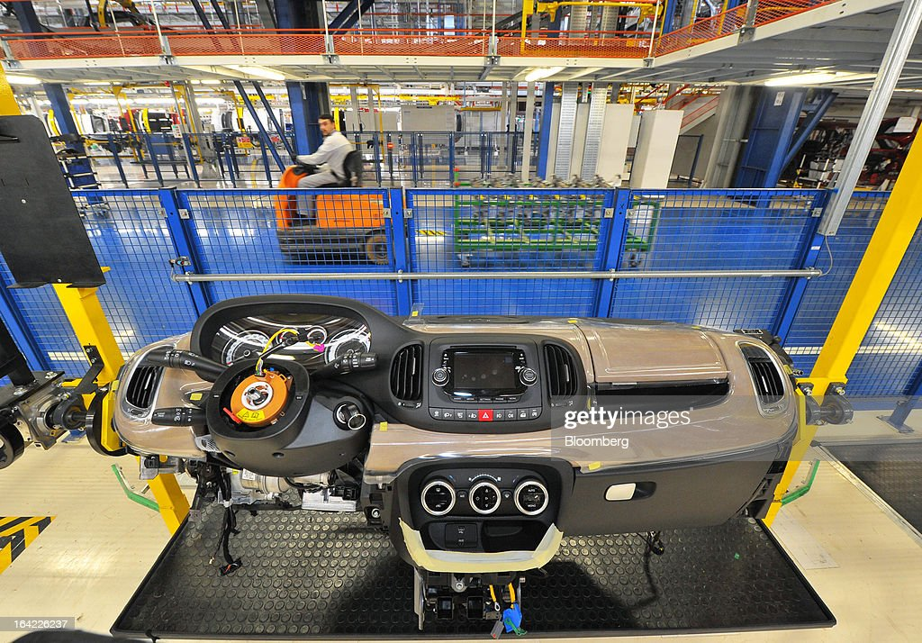 A dashboard assembly for a Fiat 500L automobile stands on the production line at the Fiat Automobili Srbija plant in Kragujevac, Serbia, on Wednesday, March 20, 2013. Fiat Automobili Srbija, a joint venture between the government and Italian carmaker Fiat, is Serbia's sole automaker. Photographer: Oliver Bunic/Bloomberg via Getty Images