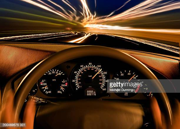 Dashboard of car, close-up, dusk, (blurred motion)