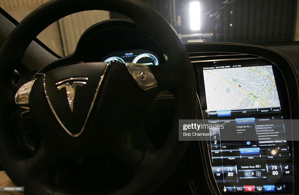 Dashboard Of Tesla Model S Electric Car Before Designer Franz Von