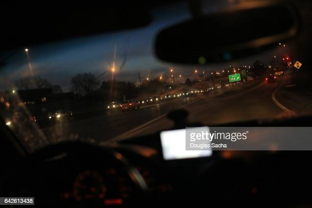 Dashboard view of a moving car on a busy highway