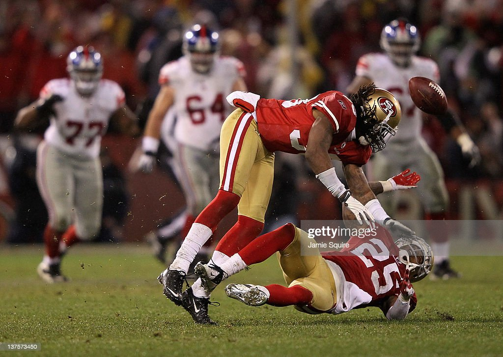 <a gi-track='captionPersonalityLinkClicked' href=/galleries/search?phrase=Dashon+Goldson&family=editorial&specificpeople=2167242 ng-click='$event.stopPropagation()'>Dashon Goldson</a> #38 and Tarell Brown #25 of the San Francisco 49ers fall to the turf after they collided with each other on a play against the New York Giants in the second half during the NFC Championship Game at Candlestick Park on January 22, 2012 in San Francisco, California.