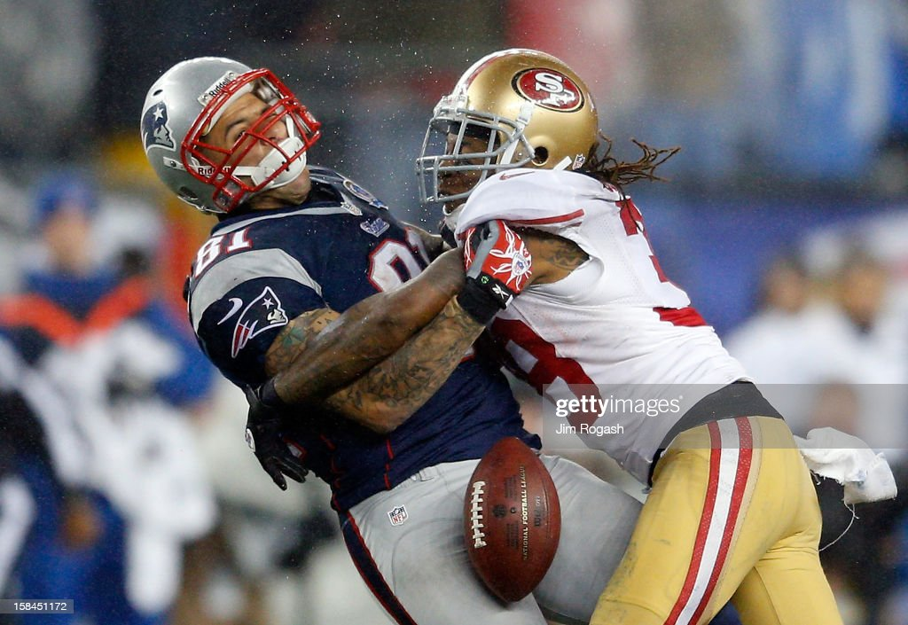 <a gi-track='captionPersonalityLinkClicked' href=/galleries/search?phrase=Dashon+Goldson&family=editorial&specificpeople=2167242 ng-click='$event.stopPropagation()'>Dashon Goldson</a> #38 of the San Francisco 49ers breaks up a pass intended for <a gi-track='captionPersonalityLinkClicked' href=/galleries/search?phrase=Aaron+Hernandez+-+American+Football+Player&family=editorial&specificpeople=4586516 ng-click='$event.stopPropagation()'>Aaron Hernandez</a> #81 of the New England Patriots in the second half against San Francisco 49ers at Gillette Stadium on December 16, 2012 in Foxboro, Massachusetts.