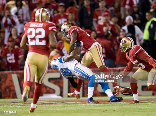 Dashon Goldson of the San Francisco 49ers decks Titus Young of the the Detroit Lions during the game at Candlestick Park on September 16 2012 in San...