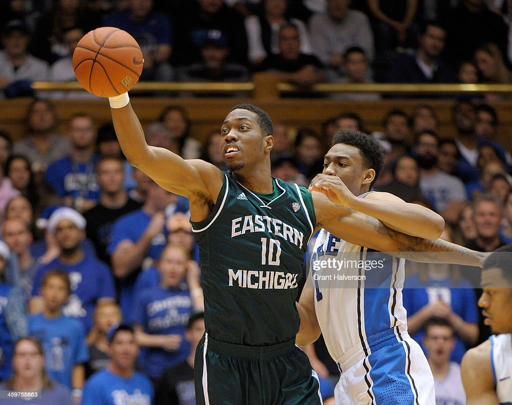 Da'Shonte Riley #10 of the Eastern Michigan Eagles rebounds against <a gi-track='captionPersonalityLinkClicked' href=/galleries/search?phrase=Jabari+Parker&family=editorial&specificpeople=9330340 ng-click='$event.stopPropagation()'>Jabari Parker</a> #1 of the Duke Blue Devils during their game at Cameron Indoor Stadium on December 28, 2013 in Durham, North Carolina. Duke won 82-59.