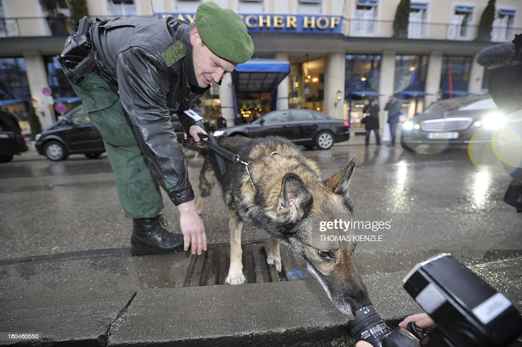 Dasko, a policeofficer's dog, sniffs the lens of a photojournalist in front of the Bayerischer Hof hotel in Munich, southern Germany, on February 1, 2013, where the 49th Munich Security Conference will start in the afternoon. The Munich Security Conference is to open with officials, ministers, top military brass and experts from 90 delegations discussing the world's hot button foreign policy issues at the three-day annual get-together. KIENZLE